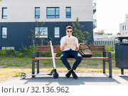 Купить «businessman with scooter reading newspaper in city», фото № 32136962, снято 1 августа 2019 г. (c) Syda Productions / Фотобанк Лори