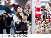 Купить «Portrait of female customer near counter with Christmas gifts», фото № 32140662, снято 22 декабря 2016 г. (c) Яков Филимонов / Фотобанк Лори