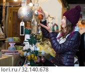 Купить «Glad young woman buying xmas gifts», фото № 32140678, снято 22 декабря 2016 г. (c) Яков Филимонов / Фотобанк Лори