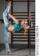 Купить «Woman practicing pole dancing in dark studio», фото № 32140954, снято 10 мая 2018 г. (c) Яков Филимонов / Фотобанк Лори