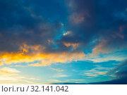 Купить «Закатный небесный пейзаж. Синее небо и золотыми облаками. Blue sky background - picturesque colorful clouds lit by sunlight. Sunset evening view», фото № 32141042, снято 21 ноября 2018 г. (c) Зезелина Марина / Фотобанк Лори