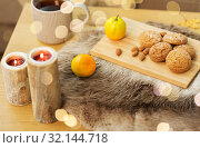 Купить «cookies, lemon tea and candles on table at home», фото № 32144718, снято 15 ноября 2017 г. (c) Syda Productions / Фотобанк Лори