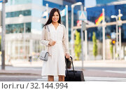Купить «happy young asian woman with travel bag in city», фото № 32144994, снято 13 июля 2019 г. (c) Syda Productions / Фотобанк Лори