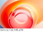Купить «Background from a multi-colored spiral close up.», фото № 32145270, снято 28 апреля 2019 г. (c) Olesya Tseytlin / Фотобанк Лори