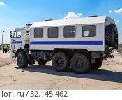 Купить «Russian police heavy truck on the city street», фото № 32145462, снято 13 апреля 2019 г. (c) FotograFF / Фотобанк Лори