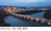 Купить «Night cityscape of Cordoba with Mosque-cathedral, Andalusia, Spain», видеоролик № 32145490, снято 22 мая 2019 г. (c) Яков Филимонов / Фотобанк Лори