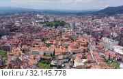 Купить «Aerial view of Oviedo city with buildings and lanscape, Asturias, Spain», видеоролик № 32145778, снято 15 июля 2019 г. (c) Яков Филимонов / Фотобанк Лори