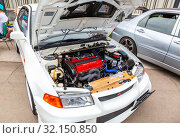 Купить «Tuned turbo car engine of Mitsubishi vehicle», фото № 32150850, снято 19 мая 2018 г. (c) FotograFF / Фотобанк Лори