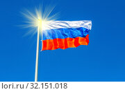 Flag of Russia waving in the wind against the sky. Стоковое фото, фотограф FotograFF / Фотобанк Лори