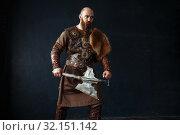 Купить «Viking with axe in traditional nordic clothes», фото № 32151142, снято 27 марта 2019 г. (c) Tryapitsyn Sergiy / Фотобанк Лори