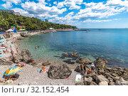 Купить «Foros. Crimea - June 30. 2019 Tourists on the city beach at Black Sea», фото № 32152454, снято 30 июня 2019 г. (c) Володина Ольга / Фотобанк Лори