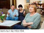 Купить «Offended elderly woman with couple berating her», фото № 32153154, снято 16 октября 2019 г. (c) Яков Филимонов / Фотобанк Лори