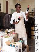 Купить «Winemaker inspecting wine bottles in store», фото № 32153170, снято 1 августа 2019 г. (c) Яков Филимонов / Фотобанк Лори