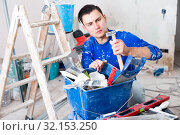 Worker looking for necessary tool in toolbox. Стоковое фото, фотограф Яков Филимонов / Фотобанк Лори