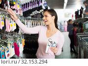 Купить «Woman shopping socks in leg-wear», фото № 32153294, снято 2 апреля 2020 г. (c) Яков Филимонов / Фотобанк Лори