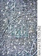 Купить «Snowfall before house window», фото № 32153362, снято 2 мая 2009 г. (c) Юрий Бизгаймер / Фотобанк Лори