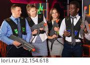 Купить «Group of glad co-workers holding laser guns», фото № 32154618, снято 4 апреля 2019 г. (c) Яков Филимонов / Фотобанк Лори