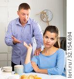 Купить «Upset woman sitting at table, quarrel with husband at home», фото № 32154694, снято 21 ноября 2019 г. (c) Яков Филимонов / Фотобанк Лори