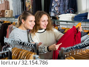 Купить «Women choosing new blouse», фото № 32154786, снято 6 декабря 2018 г. (c) Яков Филимонов / Фотобанк Лори