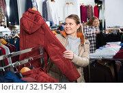 Купить «Woman shopping in outerwear clothing boutique», фото № 32154794, снято 6 декабря 2018 г. (c) Яков Филимонов / Фотобанк Лори
