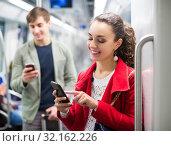 Купить «Passengers in metro wagon», фото № 32162226, снято 2 апреля 2020 г. (c) Яков Филимонов / Фотобанк Лори