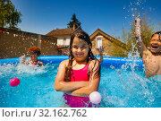 little girl pose in swimming pool with friends. Стоковое фото, фотограф Сергей Новиков / Фотобанк Лори