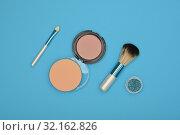 Купить «Make up blush, sponge and brush over blue», фото № 32162826, снято 29 августа 2019 г. (c) Anton Eine / Фотобанк Лори