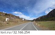 Купить «Time lapse video of driving along mountain road Chuysky Tract along Kurai Ridge on Altai at Spring season», видеоролик № 32166254, снято 3 июля 2019 г. (c) Serg Zastavkin / Фотобанк Лори