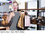 girl chosing pair of shoes. Стоковое фото, фотограф Яков Филимонов / Фотобанк Лори