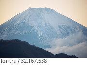 Купить «Mount Fuji summit in the clouds. Hakone area of Kanagawa Prefecture in Honshu. Japan», фото № 32167538, снято 1 декабря 2007 г. (c) Serg Zastavkin / Фотобанк Лори