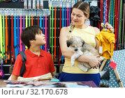 Купить «Family choosing dogs clothes in shop», фото № 32170678, снято 22 августа 2018 г. (c) Яков Филимонов / Фотобанк Лори