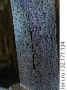 Купить «Wall of the monastery Sanahin with a carved cross on a stone close up, Armenia», фото № 32171134, снято 5 июня 2018 г. (c) Константин Лабунский / Фотобанк Лори
