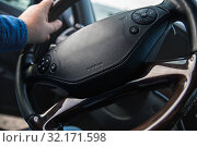 Купить «car steering wheel with shallow depth of field», фото № 32171598, снято 12 сентября 2019 г. (c) Дмитрий Бачтуб / Фотобанк Лори