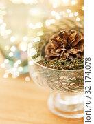 Купить «close up of christmas decoration of fir and cone», фото № 32174078, снято 15 ноября 2017 г. (c) Syda Productions / Фотобанк Лори