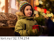 Купить «happy boy with cup of tea at christmas market», фото № 32174214, снято 4 января 2019 г. (c) Syda Productions / Фотобанк Лори