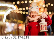 Купить «happy little girl at christmas with lantern market», фото № 32174218, снято 4 января 2019 г. (c) Syda Productions / Фотобанк Лори