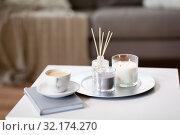 Купить «coffee, candles and aroma reed diffuser on table», фото № 32174270, снято 11 апреля 2019 г. (c) Syda Productions / Фотобанк Лори