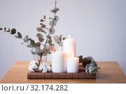 Купить «candles and branches of eucalyptus on table», фото № 32174282, снято 12 апреля 2019 г. (c) Syda Productions / Фотобанк Лори
