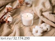Купить «burning candle and cotton flower on blanket», фото № 32174290, снято 12 апреля 2019 г. (c) Syda Productions / Фотобанк Лори