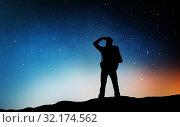 Купить «traveler standing on edge and looking far away», фото № 32174562, снято 31 августа 2014 г. (c) Syda Productions / Фотобанк Лори