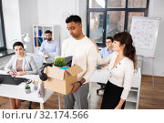 Купить «colleague seeing off sad fired male office worker», фото № 32174566, снято 23 марта 2019 г. (c) Syda Productions / Фотобанк Лори