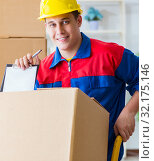 Купить «Young man working in relocation services with boxes», фото № 32175146, снято 30 июня 2017 г. (c) Elnur / Фотобанк Лори