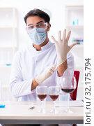 Купить «Male chemist examining wine samples at lab», фото № 32175794, снято 4 апреля 2019 г. (c) Elnur / Фотобанк Лори