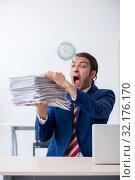 Купить «Young male businessman sitting in the office», фото № 32176170, снято 20 июня 2019 г. (c) Elnur / Фотобанк Лори