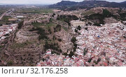 Купить «Aerial view of Sagunto city and antique roman fortress, Valencia, Spain», видеоролик № 32176258, снято 19 марта 2019 г. (c) Яков Филимонов / Фотобанк Лори
