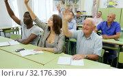 Group different ages asks questions during exam. Стоковое видео, видеограф Яков Филимонов / Фотобанк Лори