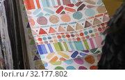 Ordinary woman choosing interesting fabric in textile shop. Стоковое видео, видеограф Vasily Alexandrovich Gronskiy / Фотобанк Лори