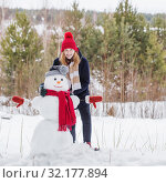 Купить «happy teenager girl with snowman in winter forest», фото № 32177894, снято 3 февраля 2019 г. (c) Майя Крученкова / Фотобанк Лори