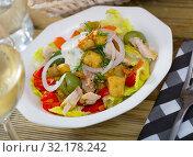 Купить «Warm salad of chicken and eggplant», фото № 32178242, снято 16 сентября 2019 г. (c) Яков Филимонов / Фотобанк Лори