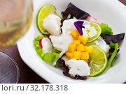 Купить «Sea food – cod ceviche with mango», фото № 32178318, снято 23 февраля 2020 г. (c) Яков Филимонов / Фотобанк Лори